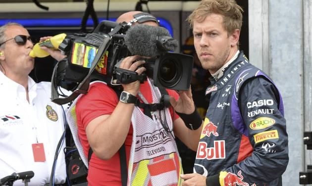 Red Bull driver Sebastian Vettel of Germany watches after he backs to the pits after failing to complete the Monaco Formula One Grand Prix, at the Monaco racetrack, in Monaco, Sunday, May 25, 2014. (AP/hoto/Boris Hovat/ Pool)
