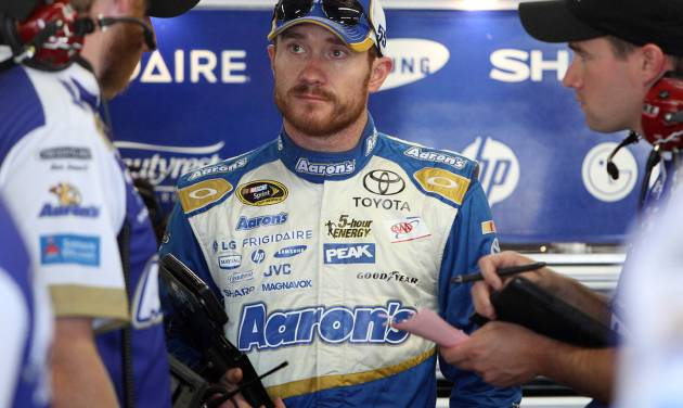 Brian Vickers talks with his crew after the morning practice for Sunday's Sprint Cup Series auto race at New Hampshire Motor Speedway, Saturday, July 12, 2014 in Loudon, N.H. (AP Photo/Jim Cole)