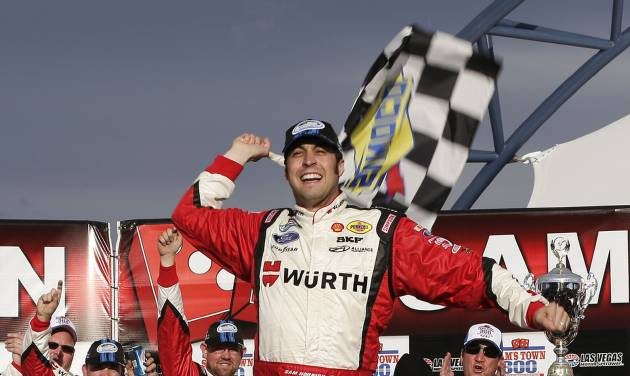 Sam Hornish Jr. celebrates in Victory Lane after winning the NASCAR Nationwide Series auto race, Saturday, March 9, 2013, in Las Vegas. (AP Photo/Julie Jacobson)