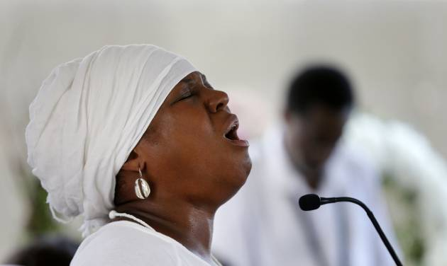 Michaela Harrison sings a hymn during a wreath-laying ceremony at the Hurricane Katrina Memorial, on the ninth anniversary of the storm, in New Orleans, Friday, Aug. 29, 2014. (AP Photo/Gerald Herbert)