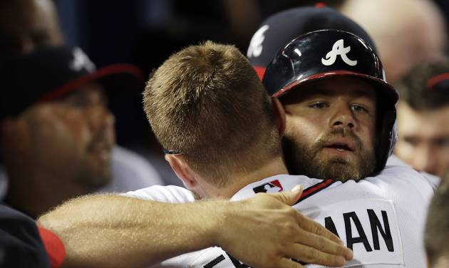 Atlanta Braves pinch hitter Evan Gattis, right,  hugs teammate Freddie Freeman after hitting a game-tying home run in the ninth inning of a baseball game against the Minnesota Twins Tuesday, May 21, 2013 in  in Atlanta. Atlanta won 5-4 in ten innings. (AP Photo/John Bazemore)