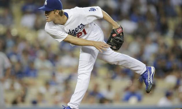 Los Angeles Dodgers starting pitcher Zack Greinke follows through on a pitch to the Cincinnati Reds during the fourth inning of a baseball game Tuesday, May 27, 2014, in Los Angeles. (AP Photo/Jae C. Hong)