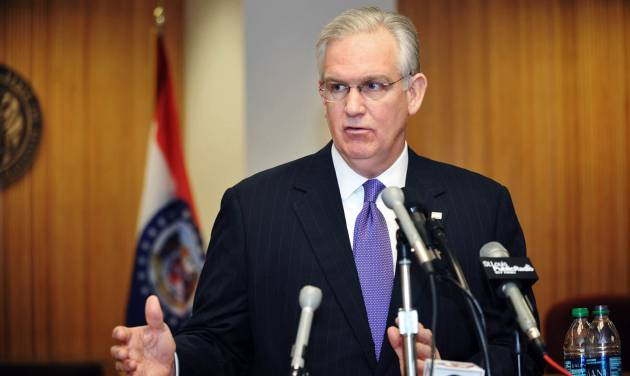 Gov. Jay Nixon holds a brief press conference in Missouri's Capitol in Jefferson City, Wednesday, April 3, 2013, to answer questions regarding a meeting with legislators over Medicaid funding. (AP PHOTO/Julie Smith)  (AP Photo/The Jefferson City News-Tribune, Julie Smith)