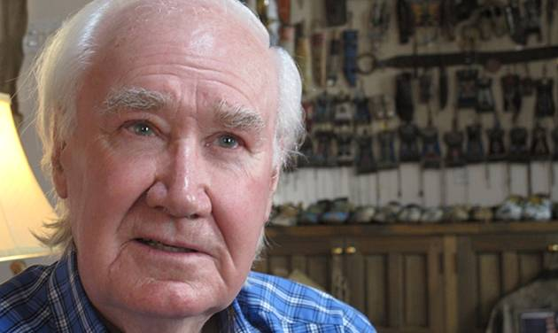 Forrest Fenn sits in his home in Santa Fe, N.M. on Friday, March 22, 2013. For more than a decade, the 82-year-old claims he has packed and repacked a treasure chest, sprinkling in gold dust and adding hundreds of rare gold coins, gold nuggets and other artifacts, and buried it in the mountains somewhere north of Santa Fe. (AP Photo/Jeri Clausing)