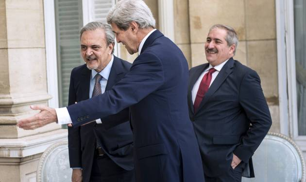 Jordanian Foreign Minister Nasser Judeh, right, US Secretary of State John Kerry, center, and Saudi Arabia's Foreign Minister Prince Saud al-Faisal walk to a meeting at the US Chief of Mission Residence in Paris, France. US Secretary of State John Kerry arrived in Paris on June 26, 2014 after stops in Baghdad, Arbil and Brussels to brief his Saudi, French and Israeli counterparts on his talks in Iraq and discuss the bloody three-year war in Syria. (AP Photo/Brendan Smialowski, pool)