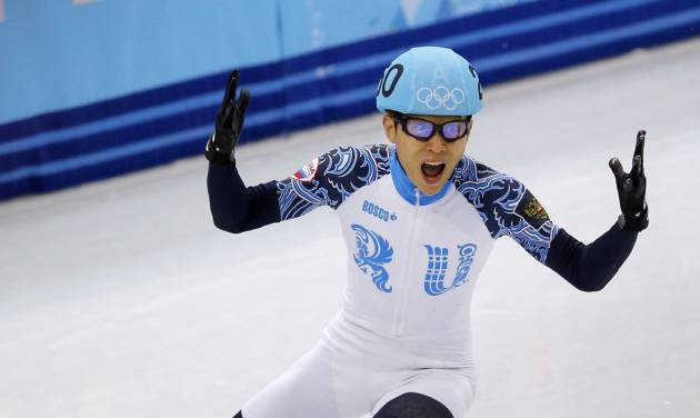 Victor An of Russia reacts as he wins the men's 500m short track speedskating final at the Iceberg Skating Palace during the 2014 Winter Olympics, Friday, Feb. 21, 2014, in Sochi, Russia. (AP Photo/Vadim Ghirda)