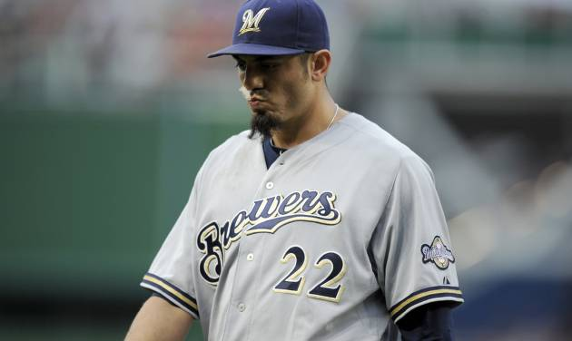 Milwaukee Brewers starting pitcher Matt Garza heads to the dugout after he was pulled from the baseball game against the Washington Nationals during the first inning Saturday, July 19, 2014, in Washington. (AP Photo/Nick Wass)