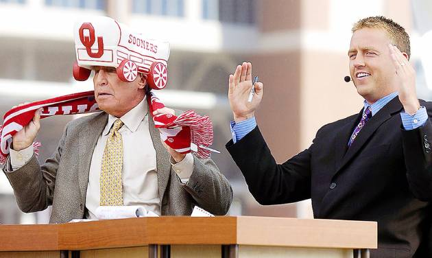 ESPN College GameDay's Lee Corso, left, puts on an OU hat and scarf as Kirk Herbstreit spells OU with his arms. The GameDay crew brought bad luck for the Sooners against Missouri last season, but OU is 17-8 overall in games visited by GameDay. Photo By Nate Billings, The Oklahoman Archive