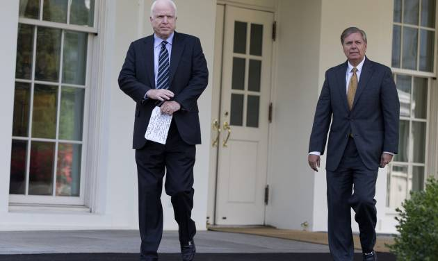 Sen. John McCain, R-Ariz., left, and Sen. Lindsey Graham, R-S.C., leave the White House in Washington, Monday, Sept. 2, 2013, following a closed-door meeting with President Barack Obama to discuss the situation with Syria. President Barack Obama, working to persuade skeptical lawmakers to endorse a U.S. military intervention in civil war-wracked Syria, hosted the two leading Capitol Hill foreign policy hawks for talks and directed his national security team to testify before Congress in a determined effort to sell his plan for limited missile strikes against Syrian President Bashar Assad's regime. (AP Photo/Evan Vucci)