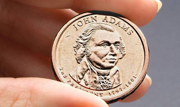 FILE - This undated file photo provided by the U.S. Mint shows the President John Adams presidential $1 coin. Congressional auditors say doing away with dollar bills entirely and replacing them with dollar coins could save taxpayers some $4.4 billion over the next 30 years. (AP Photo/US Mint, File)
