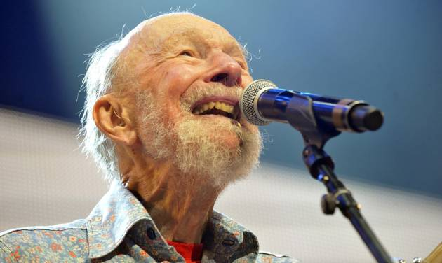 FILE - This Sept. 21, 2013, file photo shows Pete Seeger performing on stage during the Farm Aid 2013 concert at Saratoga Performing Arts Center in Saratoga Springs, N.Y. Seeger's life will be celebrated at the annual Clearwater Festival June 21-22 at Croton Point Park in Croton-On-Hudson. Seeger died in January at age 94, after surviving his wife Toshi by about seven months. Clearwater Festival organizers say the two-day show at Croton-on-Hudson starting June 21 will celebrate the couple's legacy. (AP Photo/Hans Pennink, File)