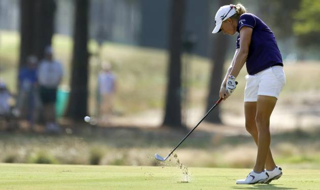 Stacy Lewis hits her approach shot on the 13th fairway during the first round of the U.S. Women's Open golf tournament in Pinehurst, N.C., Thursday, June 19, 2014. (AP Photo/Bob Leverone)