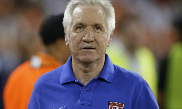 In this Sept. 3, 2013, photo, U.S. women's national soccer team coach Tom Sermanni waits for an international friendly against Mexico in Washington. U.S. Soccer says Sermanni has been fired as coach. The Americans beat China 2-0 in an exhibition game Sunday, April 6, 2014, in Commerce City, Colo. Hours later, the U.S. soccer announced the move in a news release. (AP Photo/Alex Brandon)