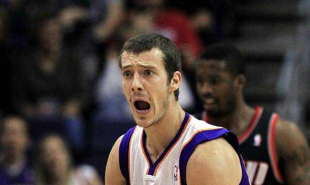 Phoenix Suns' Goran Dragic (1), of Slovenia, argues with an official after being called for a foul during the first half of an NBA preseason basketball game against the Portland Trail Blazers on Friday, Oct. 12, 2012, in Phoenix.(AP Photo/Ross D. Franklin)
