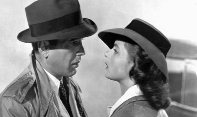 """FILE-This photo provided by Warner Bros., shows actors Ingrid Bergman and Humphrey Bogart in a scene from the film """"Casablanca."""" The piano used for the song """"As Times Goes By"""" in the classic film is getting another turn at fame. The instrument is going up for sale at Sotheby's in New York on Dec. 14, 2012, and the auction house estimates it'll fetch up to $1.2 million. It's being offered by a Japanese collector on the film's 70th anniversary. Bogart played Rick Blaine in the Oscar-winning World War II love story, opposite Bergman's character, Ilsa Lund. In a famous flashback scene, Rick and Ilsa lean on the piano at a Paris bistro as Sam, played by Dooley Wilson, plays the piano and sings. (AP Photo/Warner Bros.)"""
