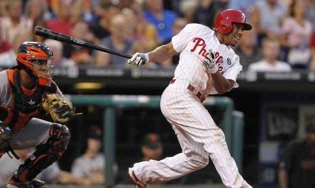 Philadelphia Phillies' Ben Revere gets a hit in the third inning of a baseball game against the San Francisco Giants, Tuesday, July 22, 2014, in Philadelphia. (AP Photo/The Philadelphia Inquirer, Ron Cortes)