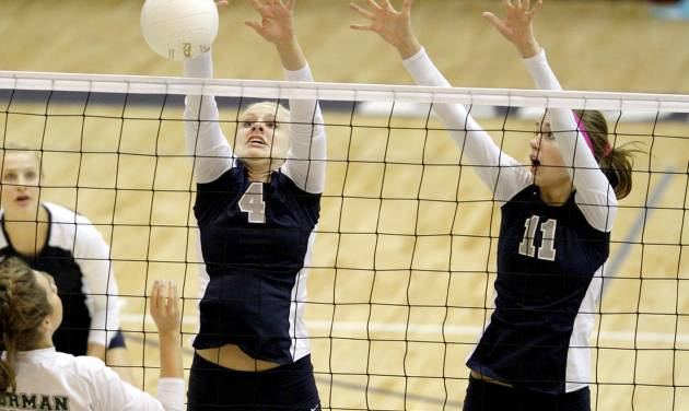 GIRLS HIGH SCHOOL VOLLEYBALL: Edmond North's Maggie Benson, left, and Sydnie Gabbard go for the block against Norman North's Grace Lamar during a volleyball match in Edmond, Okla., Tuesday, Sept. 27, 2011. Photo by Bryan Terry, The Oklahoman ORG XMIT: KOD
