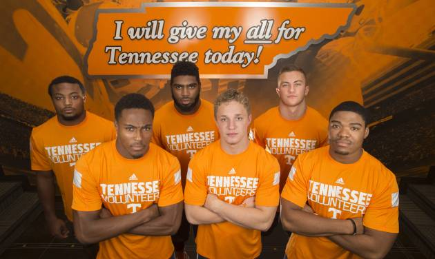 Tennessee football team freshmen Elliot Berry, Evan Berry, Neiko Creamer, Vic Wharton, Dillon Bates, and Todd Kelly, Jr., from left, pose for a portrait at the University of Tennessee Anderson Training Center in Knoxville, Tenn. on Friday, July 18, 2014. (AP Photo/Knoxville News Sentinel, Adam Lau)
