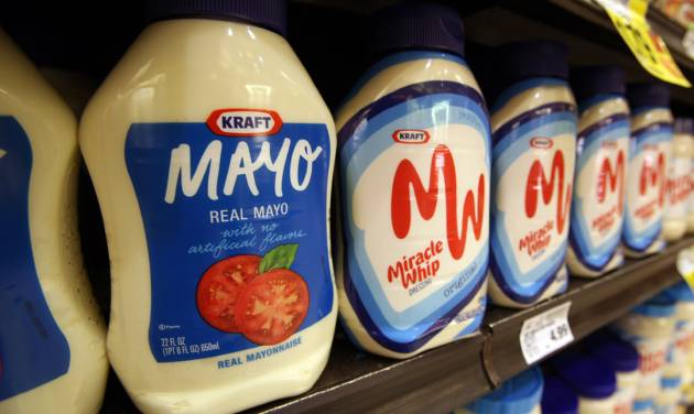 This Feb. 9, 2011, photo, shows containers of Kraft mayonnaise and Miracle Whip, at a Ralphs Fresh Fare supermarket in Los Angeles. Kraft Foods is embracing the spirit of a startup and betting that innovation will help it grow, as the maker of household names such as Oscar Mayer, Miracle Whip and Velveeta looks to redefine itself after splitting from its more glamorous global snack foods business. The company, which was established in 1903, said Wednesday, Nov. 7, 2012, that its net income rose 13 percent in the third quarter, as a mix of new products, increased advertising and productivity improvements lifted results. (AP Photo/Reed Saxon)