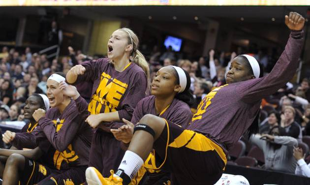 Players on the Central Michigan bench celebrate in the second half against Akron in an NCAA college basketball game in the final of the Mid-American Conference women's tournament Saturday, March 16, 2013, in Cleveland. Central Michigan won 86-68. (AP Photo/David Richard) ORG XMIT: OHDR111