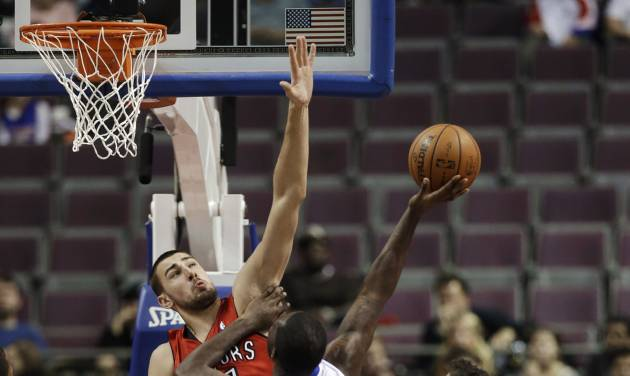 Detroit Pistons guard Rodney Stuckey (3) drives on Toronto Raptors center Jonas Valanciunas, left, of Lithuania, and Jose Calderon (8), of Spain, in the first half of a preseason NBA basketball game in Auburn Hills, Mich., Wednesday, Oct. 10, 2012. (AP Photo/Paul Sancya)