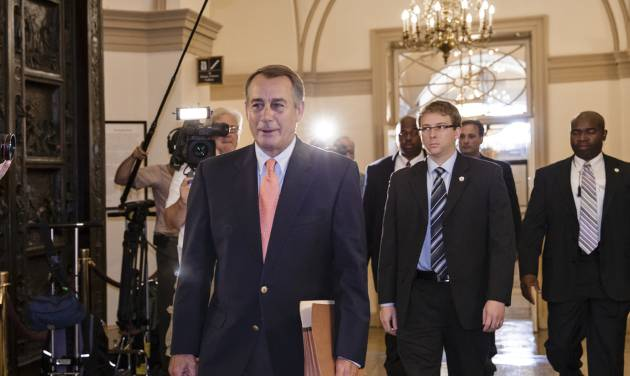 Speaker of the House John Boehner, R-Ohio, arrives at the Capitol in Washington, Saturday, Oct. 5, 2013. The Republican-controlled House and the Democrat-controlled Senate are at an impasse, neither side backing down, after House GOP conservatives linked the funding bill to President Obama's existent health care law. There has been no sign of progress toward ending the government shutdown that has idled 800,000 federal workers and curbed services around the country.  (AP Photo/J. Scott Applewhite)
