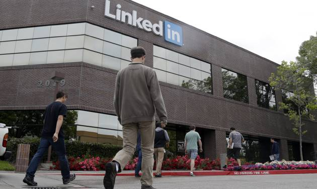 FILE - In this May 8, 2014 file photo, people walk outside of LinkedIn headquarters on in Mountain View , Calif. LinkedIn Corp. reports quarterly financial results on Thursday, July 31, 2014. (AP Photo/Marcio Jose Sanchez, File)