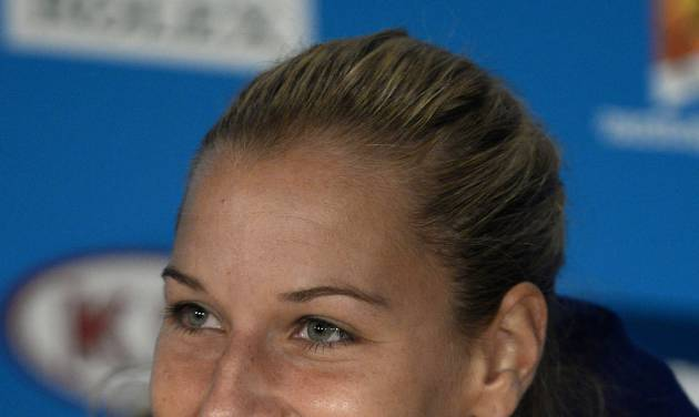 Dominika Cibulkova of Slovakia listens to a reporter's question after her loss in the women's singles final against Li Na of China at the Australian Open tennis championship in Melbourne, Australia, Saturday, Jan. 25, 2014. (AP Photo/Andrew Brownbill)