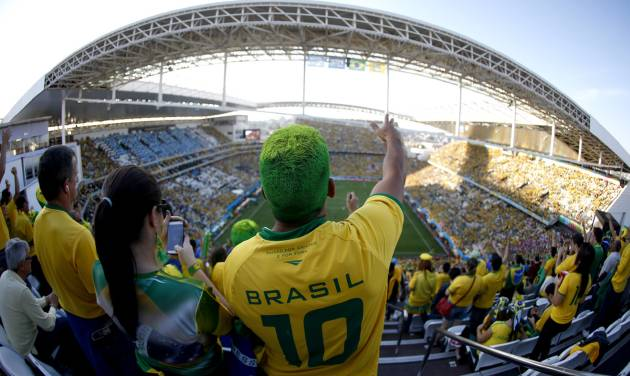 "FILE - In this June 12, 2014 file photo taken with a fisheye lens, a Brazil supporter attends the World Cup opening match between Brazil and Croatia at Itaquerao Stadium in Sao Paulo, Brazil. FIFA's number two official has said he's ""amazed"" by the levels of drunkenness in Brazil's World Cup stadiums, reviving a debate over whether alcohol sales should have been allowed at matches in the first place. (AP Photo/Julio Cortez, File)"