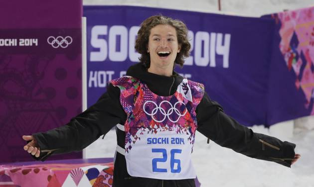 Switzerland's Iouri Podladtchikov celebrates after he won the gold medal in the men's snowboard halfpipe final at the Rosa Khutor Extreme Park, at the 2014 Winter Olympics, Tuesday, Feb. 11, 2014, in Krasnaya Polyana, Russia. (AP Photo/Andy Wong)