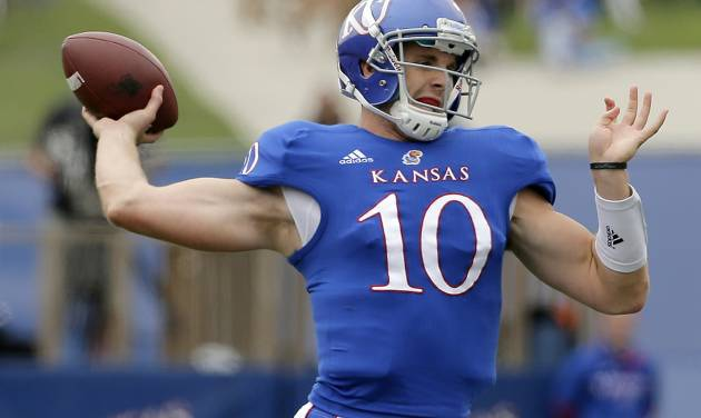 Kansas quarterback Dayne Crist (10) passes during the first half of an NCAA college football game against the TCU, Saturday, Sept. 15, 2012, in Lawrence, Kan. (AP Photo/Charlie Riedel)