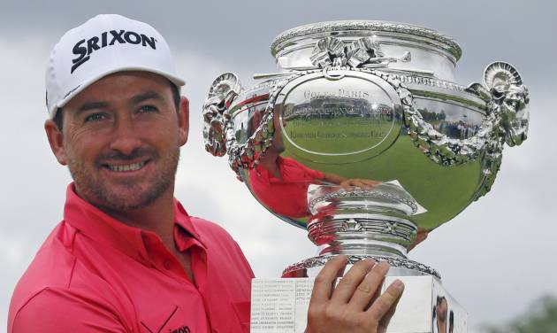 Graeme McDowell of Northern Ireland poses with his trophy after winning the French Open Golf tournament at Paris National course in Guyancourt, west of Paris, France, Sunday, July 6, 2014. (AP Photo/Francois Mori)