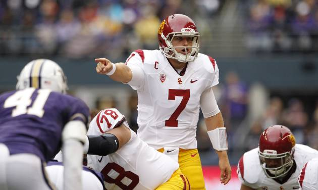 Southern California quarterback Matt Barkley directs his team against Washington during the first half of an NCAA college football game Saturday, Oct. 13, 2012, in Seattle. (AP Photo/Elaine Thompson)