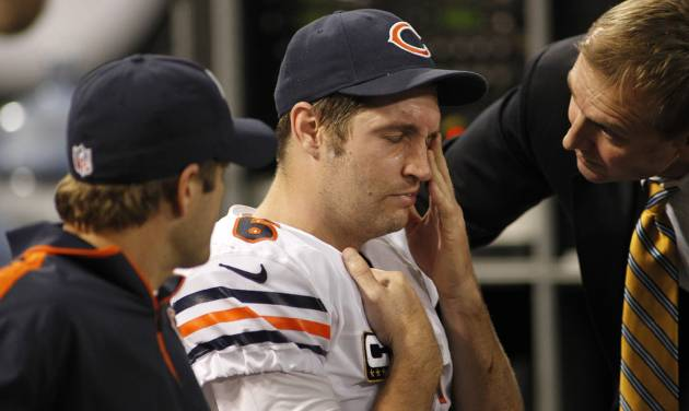 Chicago Bears quarterback Jay Cutler, center, reacts as he sits on the bench after getting injured during the second half of an NFL football game against the Minnesota Vikings Sunday, Dec. 9, 2012, in Minneapolis. (AP Photo/Andy King)