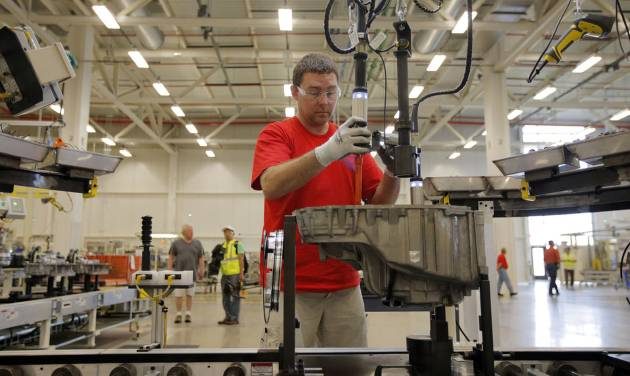 In this May 13, 2014 photo, Brian Moorman, of Russiaville, Ind., works on the line of a Chrysler transmission manufacturing facility in Tipton, Ind. The Conference Board reports on its index of leading economic indicators for April on Thursday, May 22, 2014. (AP Photo/AJ Mast)