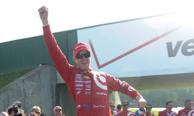 Scott Dixon, of New Zealand, celebrates standing on his car after winning the IndyCar Honda Indy 200 auto racing at Mid-Ohio Sports Car Course in Lexington, Ohio Sunday, Aug. 3, 2014. Dixon won the race from the last starting place on the grid. (AP Photo/Tom E. Puskar)