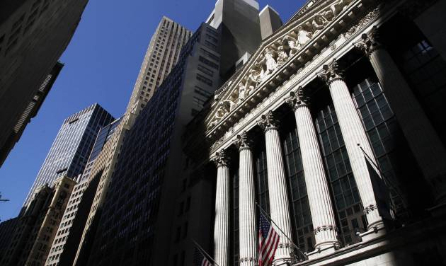 FILE - This July 15, 2013 file photo shows the New York Stock Exchange, in New York. World stock markets struggled Friday June 20, 2014as the euphoria faded from the Fed's promises of prolonged low rates to boost growth. (AP Photo/Mark Lennihan, File)