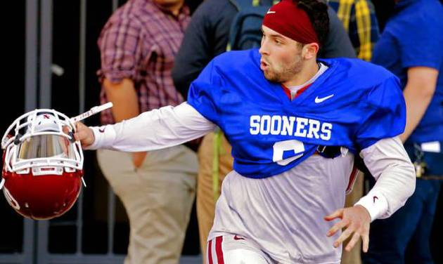 Baker Mayfield (6) leaves practice and scrambles to avoid traffic on Jenkins Ave. as the University of Oklahoma Sooners (OU) finish their first spring workout at Gaylord Family-Oklahoma Memorial Stadium in Norman, Okla., on Tuesday, March 8, 2016. Photo by Steve Sisney, The Oklahoman
