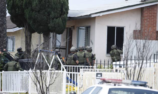 Police standoff in San Diego after officers shot