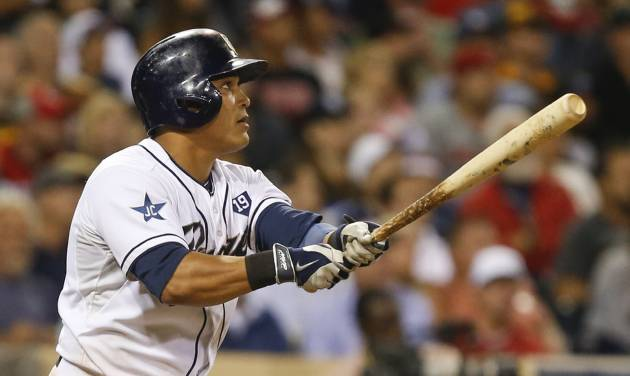 San Diego Padres' Everth Cabrera watches his deep fly to center field against the Cincinnati Reds that brings in Tommy Medica from third base with the game's first run in the fifth inning of a baseball game Monday, June 30, 2014, in San Diego.  (AP Photo/Lenny Ignelzi)