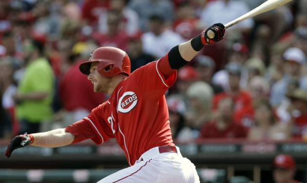 Cincinnati Reds' Zack Cozart hits a double off Philadelphia Phillies starting pitcher Roberto Hernandez to drive in a run in the fourth inning of a baseball game, Saturday, June 7, 2014, in Cincinnati. (AP Photo/Al Behrman)