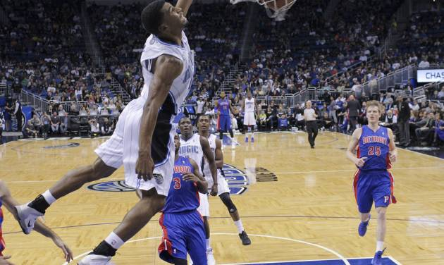Orlando Magic's Ronnie Price, front left, dunks the ball as he gets out in front of Detroit Pistons' Rodney Stuckey (3) and Kyle Singler (25) during the first half of an NBA basketball game in Orlando, Fla., Friday, Dec. 27, 2013. (AP Photo/John Raoux)