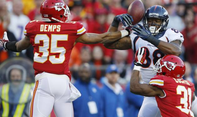 Kansas City Chiefs defensive back Quintin Demps (35) breaks up a pass intended for Denver Broncos wide receiver Demaryius Thomas (88) during the first half of an NFL football game, Sunday, Dec. 1, 2013, in Kansas City, Mo. (AP Photo/Orlin Wagner)