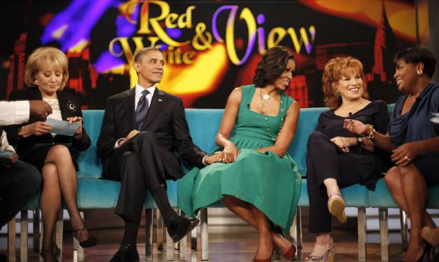 "President Barack Obama and first lady Michelle Obama appear on the ABC Television show ""The View"" in New York, Monday, Sept. 24, 2012, From left are, Barbara Walters, president and first lady, Joy Behar, and Sherri Shepherd. (AP Photo/Pablo Martinez Monsivais)"