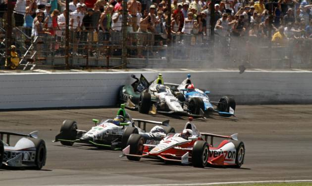 Ed Carpenter (20) and James Hinchcliffe, (27) of Canada, crash in the first turn during the 98th running of the Indianapolis 500 IndyCar auto race at the Indianapolis Motor Speedway in Indianapolis, Sunday, May 25, 2014. (AP Photo/Steve Metz)