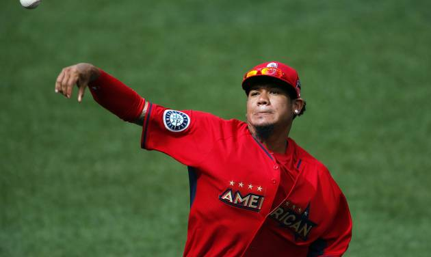 American League starting pitcher Felix Hernandez throws in the outfield during batting practice for the MLB All-Star baseball game, Monday, July 14, 2014, in Minneapolis. (AP Photo/Paul Sancya)