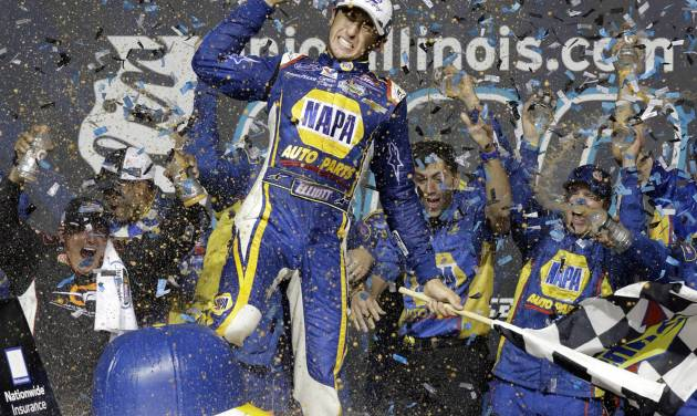 Chase Elliott (9) celebrates with teammates in Victory Lane after winning the NASCAR Nationwide Series auto race at Chicagoland Speedway in Joliet, Ill., Saturday, July 19, 2014. (AP Photo/Nam Y. Huh)