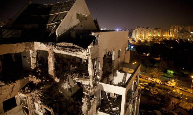 "A damaged residential building is seen after it was hit by a rocket fired by militants from the Gaza Strip, in the Israeli central city of Rishon Lezion, near Tel Aviv, Tuesday, Nov. 20, 2012. A diplomatic push to end Israel's nearly weeklong offensive in the Gaza Strip gained momentum Tuesday, with Egypt's president predicting that airstrikes would end within hours and Israel's prime minister saying his country would be a ""willing partner"" to a cease-fire with the Islamic militant group Hamas. (AP Photo/Oded Balilty)"