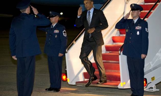 President Barack Obama salutes as he exits Air Force One as he returns to Andrews Air Force Base, Md., Thursday, July 17, 2014, after stops in Delaware and New York. (AP Photo/Jacquelyn Martin)