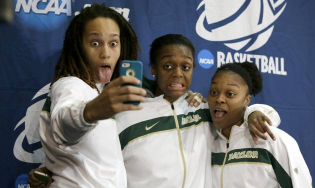 From left, Baylor's Brittney Griner, Brooklyn Pope and Odyssey Sims, right, pose for a self portrait on the stage after a news conference following their second-round game against Florida State in the women's NCAA college basketball tournament, Tuesday, March 26, 2013, in Waco, Texas. Baylor won 85-47. (AP Photo/Tony Gutierrez)